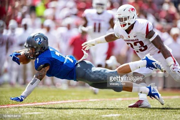 Aaron Gooch of the Eastern Illinois Panthers dives for a first down during a game against the Arkansas Razorbacks at Razorback Stadium on September 1...