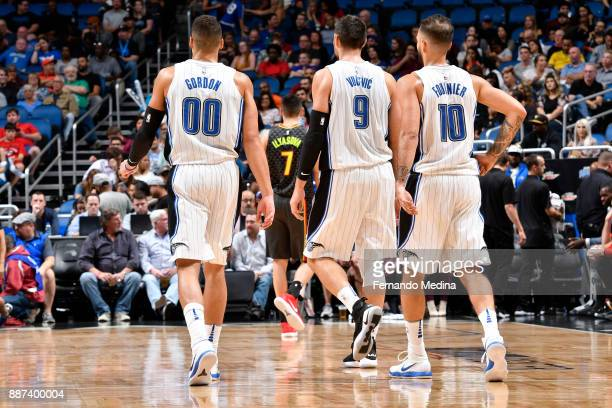 Aaron Gordon Nikola Vucevic and Evan Fournier of the Orlando Magic look on during game against the Atlanta Hawks on December 6 2017 at Amway Center...