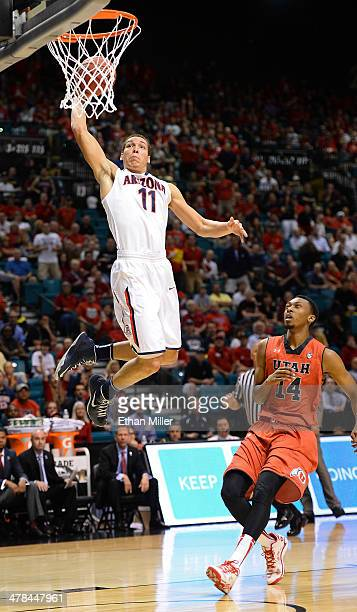 Aaron Gordon of the Arizona Wildcats dunks ahead of Dakarai Tucker of the Utah Utes during a quarterfinal game of the Pac12 Basketball Tournament at...