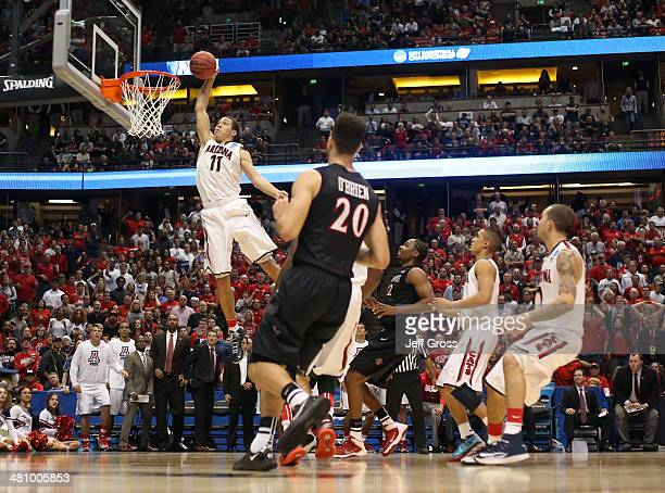Aaron Gordon of the Arizona Wildcats dunks the ball in the second half while taking on the San Diego State Aztecs during the regional semifinal of...