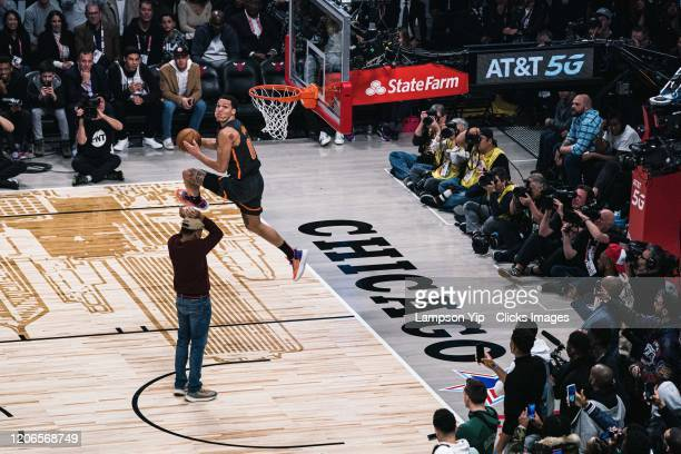 Aaron Gordon of the Orlando Magic and performer Chance The Rapper participates in the 2020 NBA AllStar ATT Slam Dunk on February 15 2020 at the...
