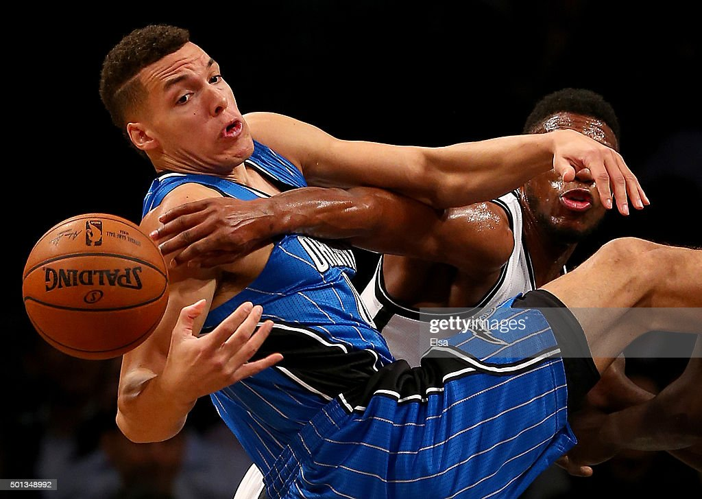 Aaron Gordon #00 of the Orlando Magic and Thaddeus Young #30 of the Brooklyn Nets fight for the ball in the first half at Barclays Center on December 14, 2015 in the Brooklyn borough of New York City.NOTE