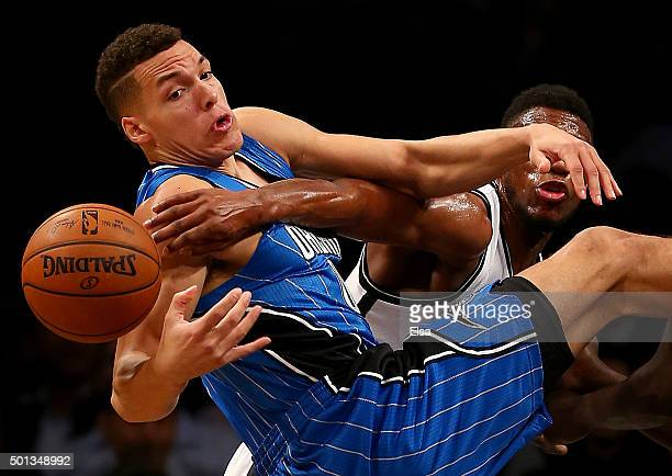 Aaron Gordon of the Orlando Magic and Thaddeus Young of the Brooklyn Nets fight for the ball in the first half at Barclays Center on December 14 2015...