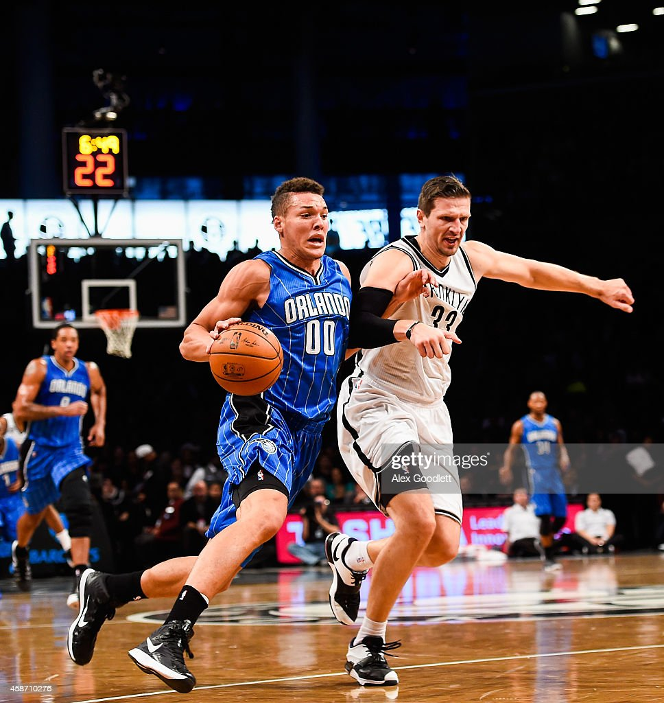 Aaron Gordon #00 of the Orlando Magic attempts to dribble past Mirza Teletovic #33 of the Brooklyn Nets in the first half at the Barclays Center on November 9, 2014 in the Brooklyn borough of New York City.