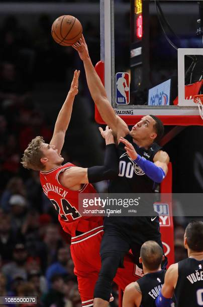 Aaron Gordon of the Orlando Magic blocks a shot by Lauri Markkanen of the Chicago Bulls at United Center on December 21 2018 in Chicago Illinois NOTE...