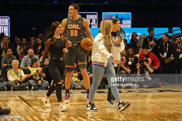 Aaron Gordon of the Orlando Magic brings out Tick Tok Stars Charli D'Amelio Addison Rae Easterling and Dixie D'Amelio during NBA AllStar Saturday...