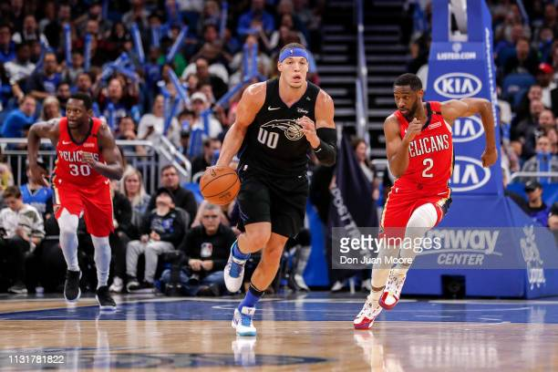 Aaron Gordon of the Orlando Magic brings the ball up court while being defended by Ian Clark of the New Orlean Pelicans during the game at the Amway...