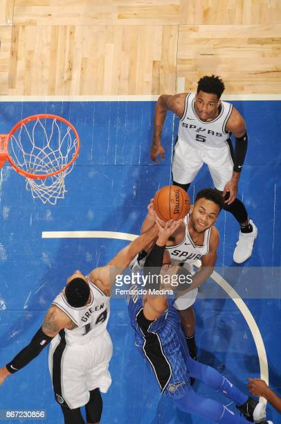 Aaron Gordon of the Orlando Magic Danny Green of the San Antonio Spurs and Kyle Anderson of the San Antonio Spurs vie for the ball during the game on...