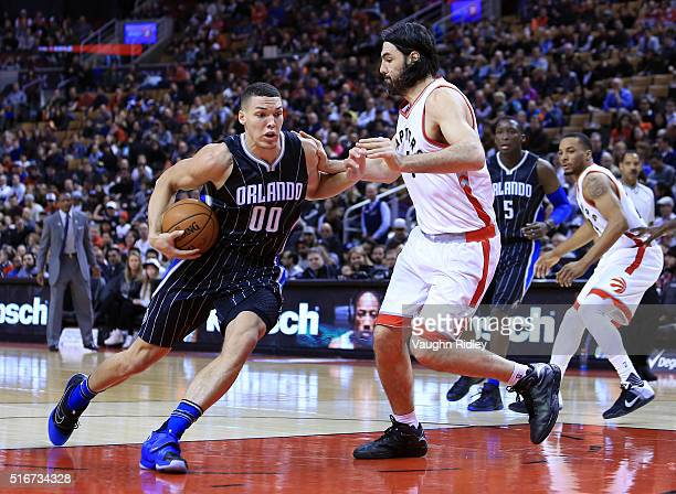 Aaron Gordon of the Orlando Magic dribbles the ball as Luis Scola of the Toronto Raptors defends during the first half of an NBA game at the Air...