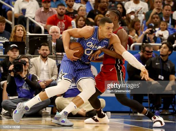 Aaron Gordon of the Orlando Magic drives against Josh Richardson of the Miami Heat during the game at Amway Center on October 17 2018 in Orlando...