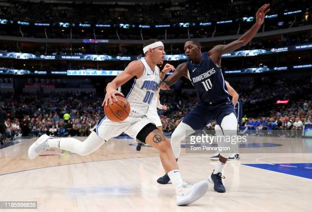 Aaron Gordon of the Orlando Magic drives to the basket against Dorian FinneySmith of the Dallas Mavericks in the first quarter at American Airlines...