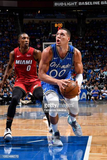 Aaron Gordon of the Orlando Magic drives to the basket against Josh Richardson of the Miami Heat on October 17 2018 at Amway Center in Orlando...