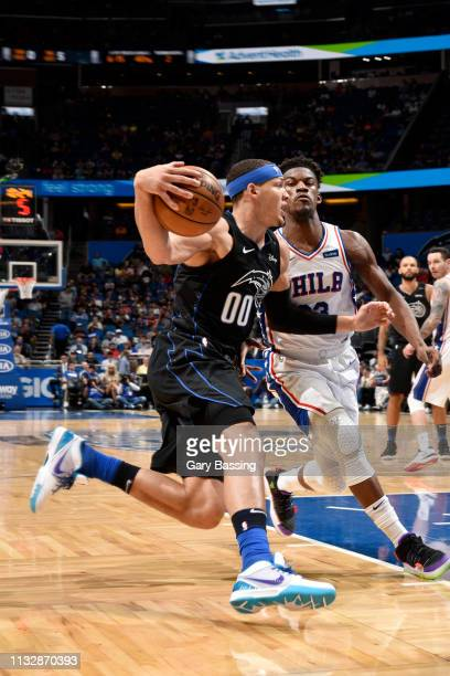 Aaron Gordon of the Orlando Magic drives to the basket against the Philadelphia 76ers on March 25 2019 at Amway Center in Orlando Florida NOTE TO...