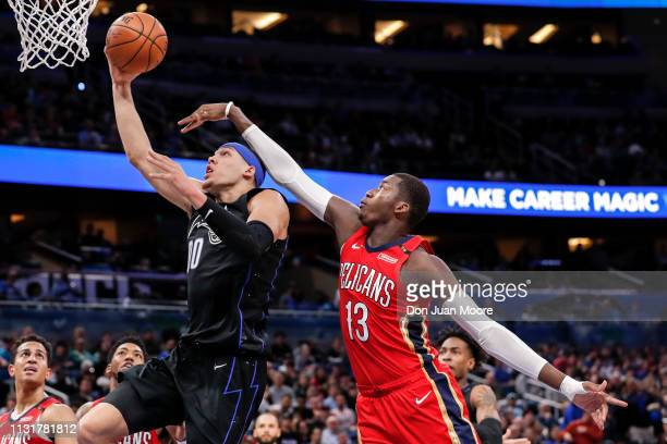 Aaron Gordon of the Orlando Magic drives to the basket over Cheick Diallo the New Orlean Pelicans during the game at the Amway Center on March 20...