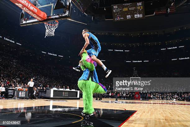 Aaron Gordon of the Orlando Magic dunks over the stuff the magic dragon the mascot of the Orlando Magic during the Verizon Slam Dunk Contest during...