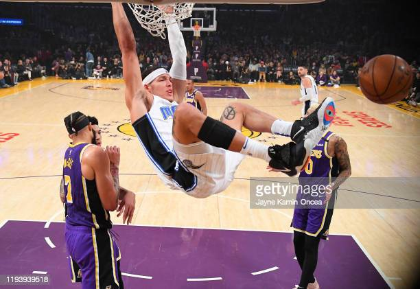 Aaron Gordon of the Orlando Magic dunks the ball as JaVale McGee Danny Green and Kyle Kuzma of the Los Angeles Lakers look on in the first half of...