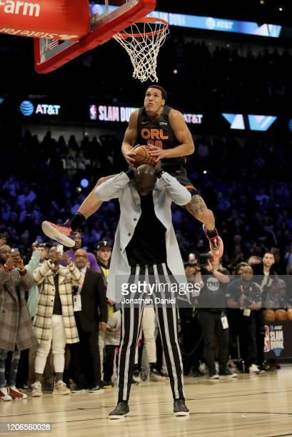 Aaron Gordon of the Orlando Magic dunks the ball over Tacko Fall of the Boston Celtics in the 2020 NBA AllStar ATT Slam Dunk Contest during State...