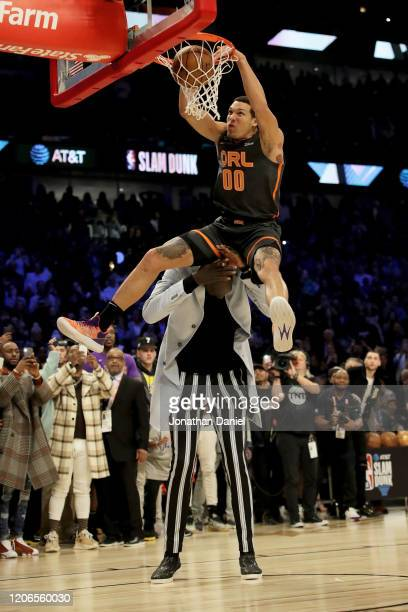 Aaron Gordon of the Orlando Magic dunks the ball over Tacko Fall of the Boston Celtics in the 2020 NBA AllStar ATT Slam Dunk Contest during State...
