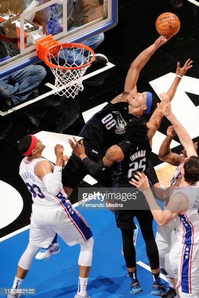 Aaron Gordon of the Orlando Magic goes to the basket against the Philadelphia 76ers on March 25 2019 at Amway Center in Orlando Florida NOTE TO USER...