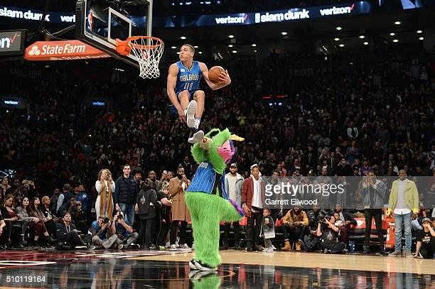 Aaron Gordon of the Orlando Magic goes up for a dunk over the Orlando Magic mascot during the Verizon Slam Dunk Contest as part of 2016 NBA AllStar...