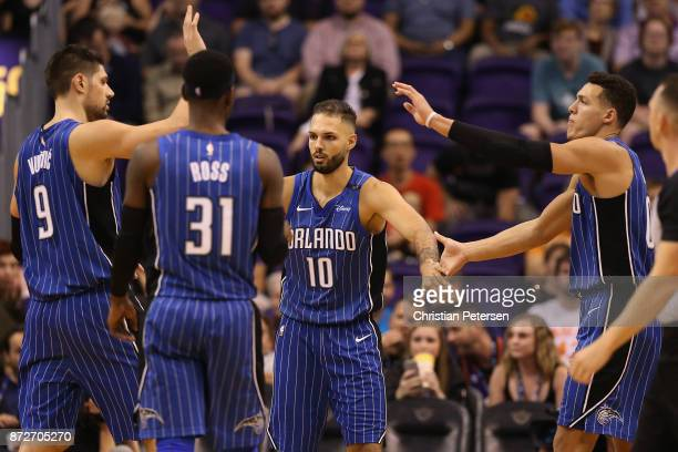 Aaron Gordon of the Orlando Magic high fives Nikola Vucevic Terrence Ross and Evan Fournier after scoring against the Phoenix Suns during the second...