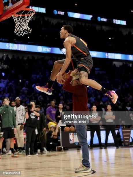 Aaron Gordon of the Orlando Magic leaps over Chance the Rapper in the 2020 NBA AllStar ATT Slam Dunk Contest during State Farm AllStar Saturday Night...