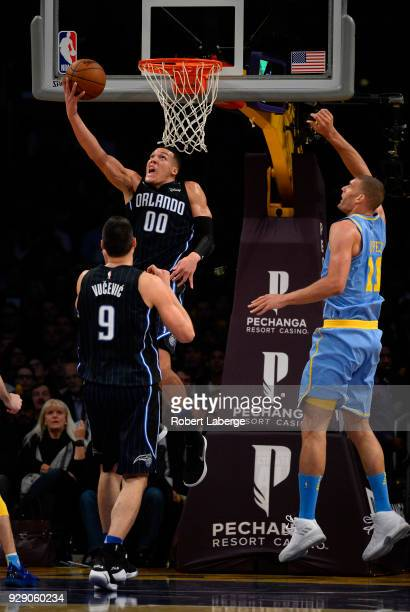 Aaron Gordon of the Orlando Magic makes a lay up against Brook Lopez of the Los Angeles Lakers on March 7 2018 at STAPLES Center in Los Angeles...