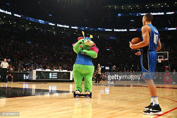 Aaron Gordon of the Orlando Magic prepares for a dunk with Stuff the Magic Dragon in the Verizon Slam Dunk Contest during NBA AllStar Weekend 2016 at...