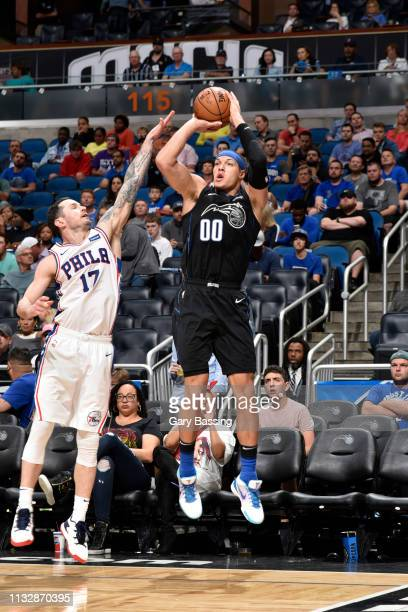 Aaron Gordon of the Orlando Magic shoots a three point basket against the Philadelphia 76ers on March 25 2019 at Amway Center in Orlando Florida NOTE...