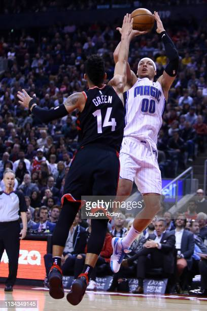 Aaron Gordon of the Orlando Magic shoots the ball as Danny Green of the Toronto Raptors defends during the first half of an NBA game at Scotiabank...