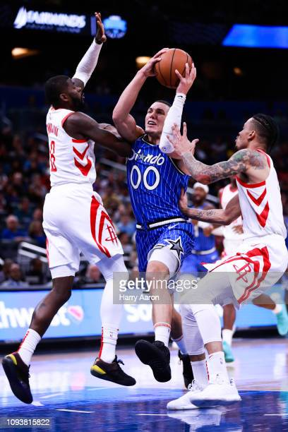 Aaron Gordon of the Orlando Magic tries to find an opening against James Ennis and Gerald Green of the Houston Rockets at Amway Center on January 13...