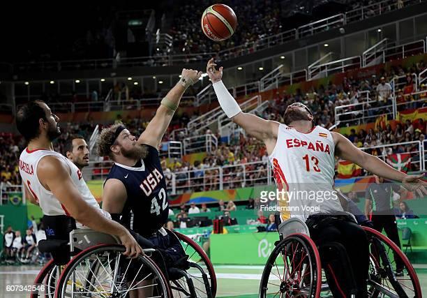 Aaron Gouge of USA and Asier Garcia of Spain in action during Men's Wheelchair Basketball Gold Medal match between Spain and USA on day 10 of the Rio...