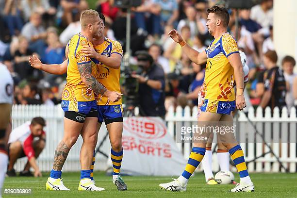 Aaron Gray of City celebrates with his team mates Chad Townsend and Clint Gutherson of City after scoring a try during the NSW Origin match between...