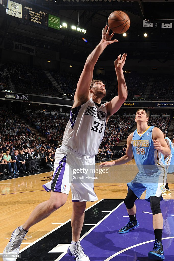 Aaron Gray #33 of the Sacramento Kings goes up for the shot against the Denver Nuggets at Sleep Train Arena on January 26, 2014 in Sacramento, California.