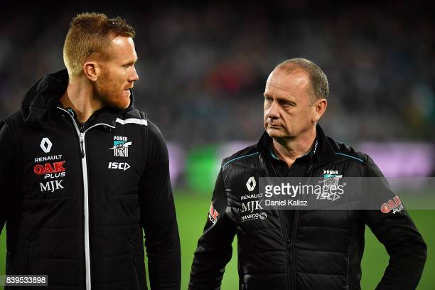 Aaron Greaves Head of Football Development for the Power chats with Ken Hinkley the coach of the Power during the round 23 AFL match between the Port...