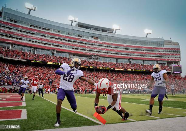 Aaron Green of the Nebraska Cornhuskers scores a touchdown during first half action of their game against the Washington Huskies at Memorial Stadium...