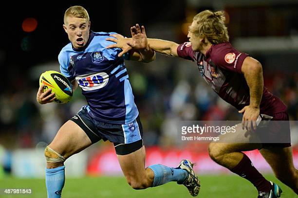 Aaron Grey of NSW palms off Brendan Elliot of Queensland during the U20's State of Origin match between the New South Wales Blues and the Queensland...