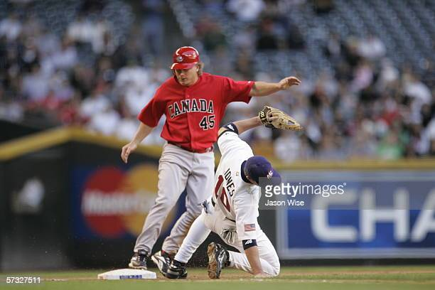 Aaron Guiel of Canada reaches base while Chipper Jones of USA fields during the game on Wednesday March 8th 2006 against Canada at Chase Field in...