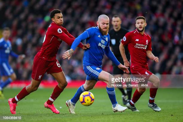 Aaron Gunnarsson of Cardiff City and Trent AlexanderArnold of Liverpool during the Premier League match between Liverpool FC and Cardiff City at...