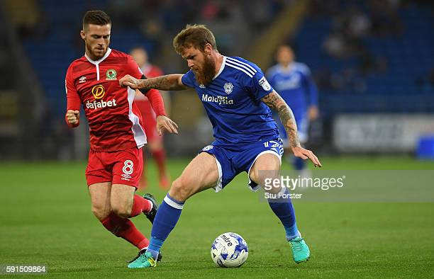 Aaron Gunnarsson of Cardiff holds off the challenge of Jack Byrne of Blackburn during the Sky Bet Championship match between Cardiff City and...