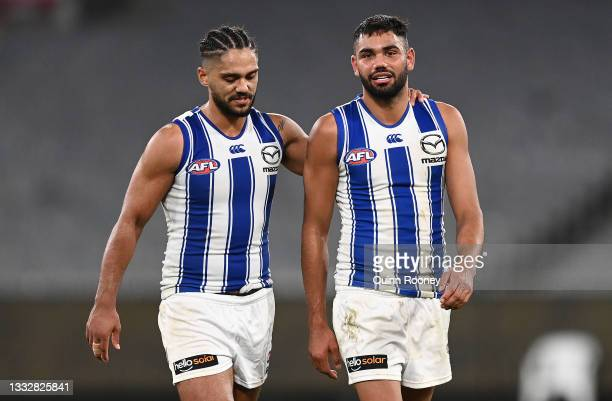 Aaron Hall and Tarryn Thomas of the Kangaroos look dejected after losing the round 21 AFL match between Richmond Tigers and North Melbourne Kangaroos...