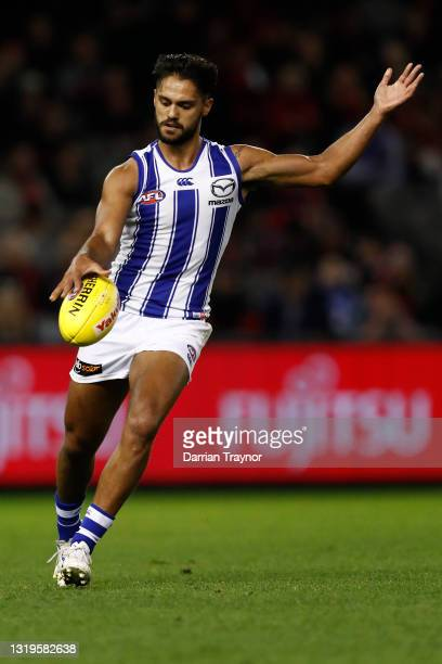 Aaron Hall of the Kangaroos kicks the ball during the round 10 AFL match between the Essendon Bombers and the North Melbourne Kangaroos at Marvel...