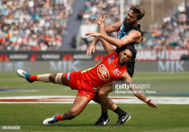 Aaron Hall of the Suns and Justin Westhoff of the Power compete for the ball during the 2017 AFL round 08 match between the Gold Coast Suns and Port...