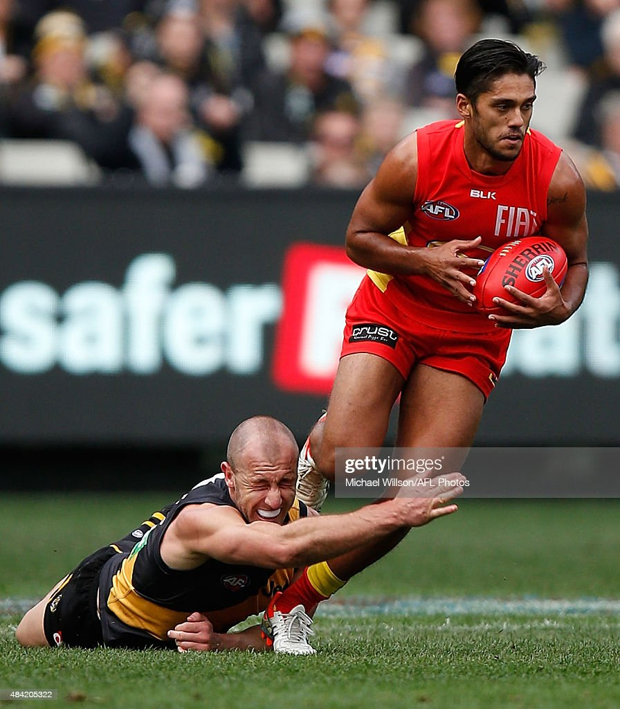 Aaron Hall of the Suns and Matt Thomas of the Tigers in action during the 2015 AFL round 20 match between the Richmond Tigers and the Gold Coast Suns at the Melbourne Cricket Ground, Melbourne, Australia on August 16, 2015.