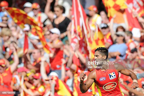 Aaron Hall of the Suns celebrates kicking a goal during the round six AFL match between the Gold Coast Suns and the Greater Western Sydney Giants at...