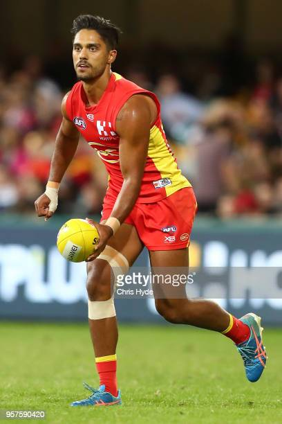 Aaron Hall of the Suns handballs during the round eight AFL match between the Gold Coast Suns and the Melbourne Demons at The Gabba on May 12 2018 in...