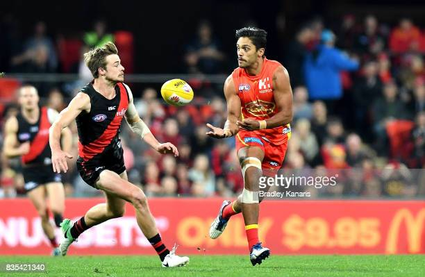 Aaron Hall of the Suns in action during the round 22 AFL match between the Gold Coast Suns and the Essendon Bombers at Metricon Stadium on August 19...