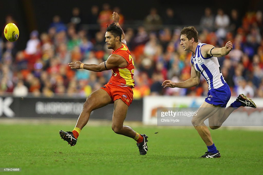 Aaron Hall of the Suns kicks during the round 14 AFL match between the Gold Coast Suns and the North Melbourne Kangaroos at Metricon Stadium on July 4, 2015 in Gold Coast, Australia.