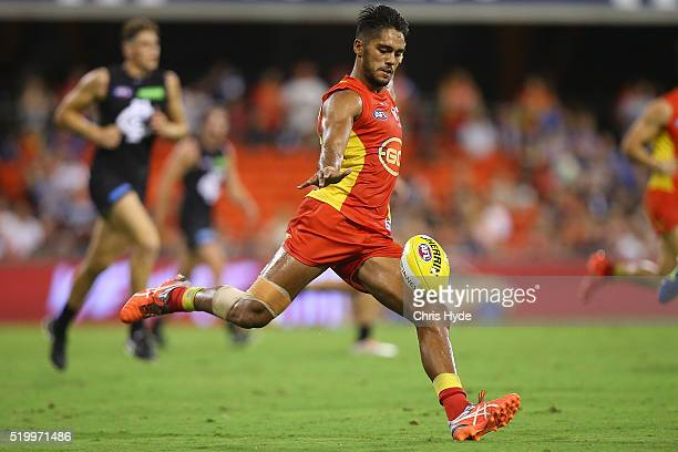 Aaron Hall of the Suns kicks during the round three AFL match between the Gold Coast Suns and the Carlton Blues at Metricon Stadium on April 9 2016...