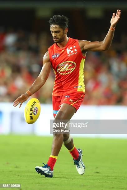 Aaron Hall of the Suns kicks during the round three AFL match between the Gold Coast Suns and the Hawthorn Hawks at Metricon Stadium on April 9 2017...
